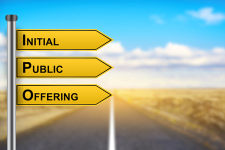 initial public offerings: IPO or Initial public offering words on yellow road sign with blurred background Stock Photo