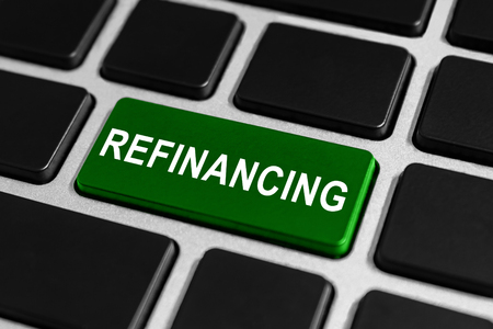refinancing: refinancing green button on keyboard, business concept Stock Photo