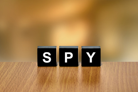 undercover agent: spy on black block with blurred background Stock Photo