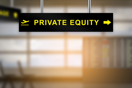 acquisitions: private equity on airport sign board with blurred background and copy space Stock Photo