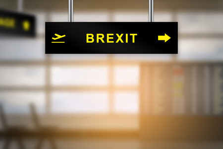 yes or no to euro: brexit or british exit on airport sign board with blurred background and copy space Stock Photo