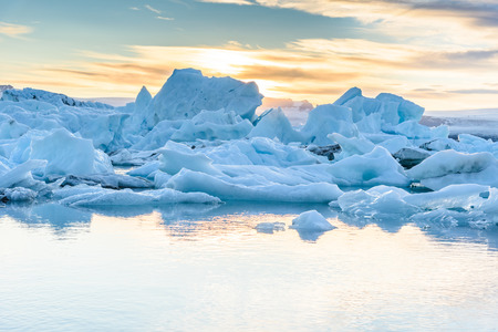 Beautiful view of icebergs in Jokulsarlon glacier lagoon at sunset, Iceland, selective focus, global warming and climate change concept
