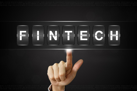 business hand pushing fintech or financial technology on Flipboard Display