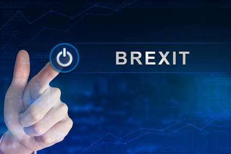 exit button: double exposure business hand clicking brexit or british exit button with blurred background