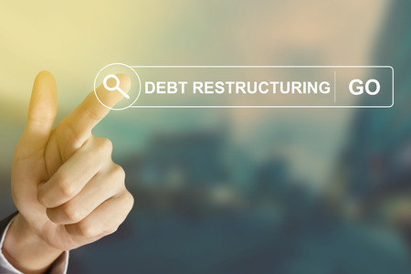 restructuring: business hand clicking debt restructuring button on search toolbar with vintage style effect