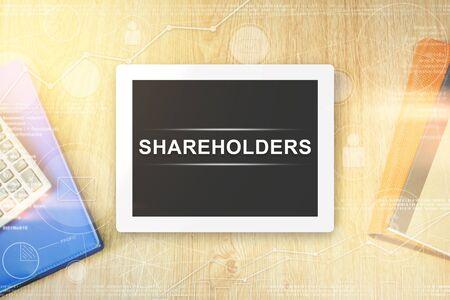 stockholder: shareholders word on tablet with soft light vintage effect