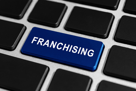 franchising: franchising blue button on keyboard, business concept Stock Photo