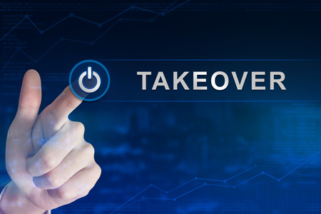 takeover: double exposure business hand clicking takeover button with blurred background