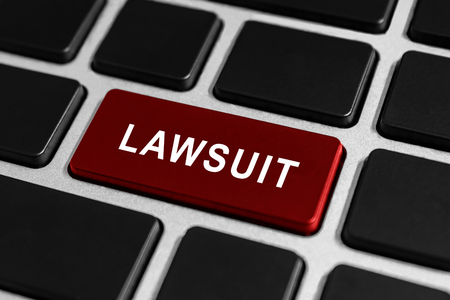 fair trial: lawsuit red button on keyboard, business concept