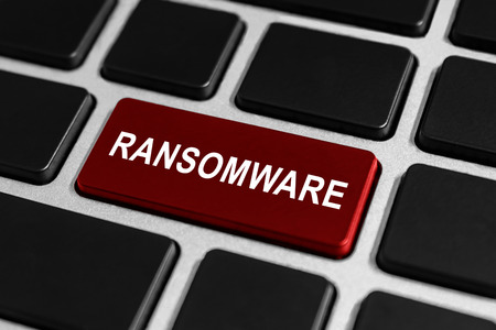 ransomware red button on keyboard, business concept Stock Photo