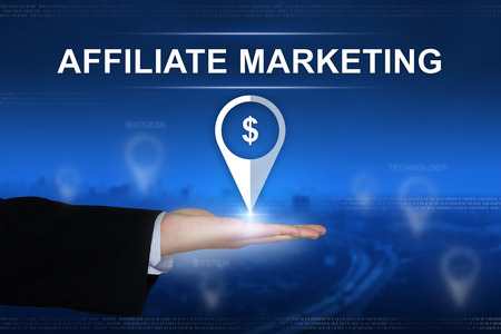 affiliate: affiliate marketing button with business hand on blurred background