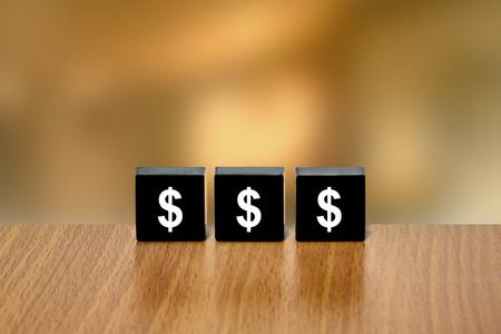 black block: usd dollar on black block with blurred background