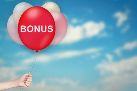 Hand Holding bonus Balloon with sky blurred background