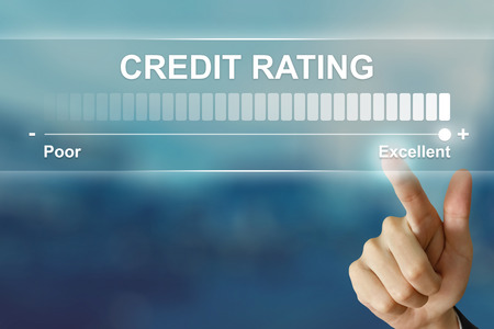 customer records: business hand pushing excellent credit rating on virtual screen interface