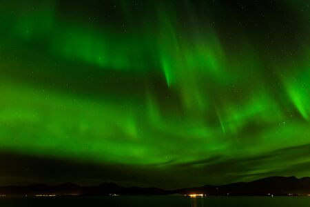 ionosphere: A beautiful green Aurora borealis or northern lights at Tromso, Norway