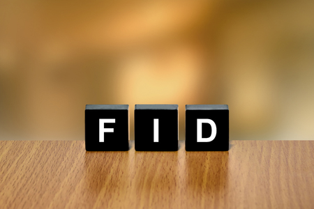 black block: FID or final investment decision on black block with blurred background