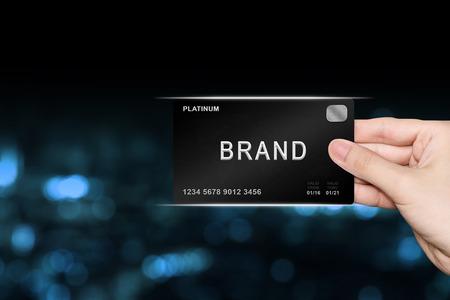 hand picking brand platinum card on blur background
