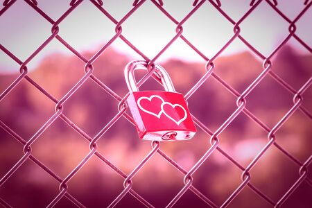Two hearts on Love Lockers on the fence with pink tone style Standard-Bild
