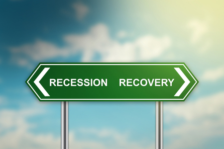 recession and recovery on green road sign with blurred blue sky, dark and bright side concept