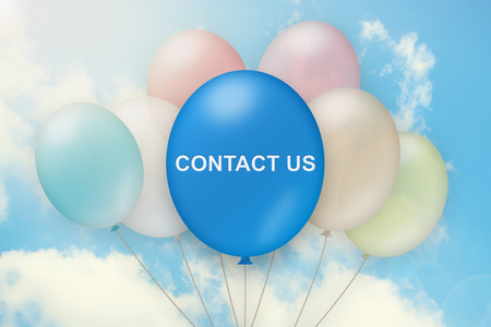 contact us on balloon with blue sky background