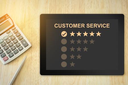 excellent five stars customer service on tablet with soft light vintage effect