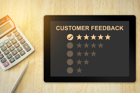 excellent five stars customer feedback on tablet with soft light vintage effect