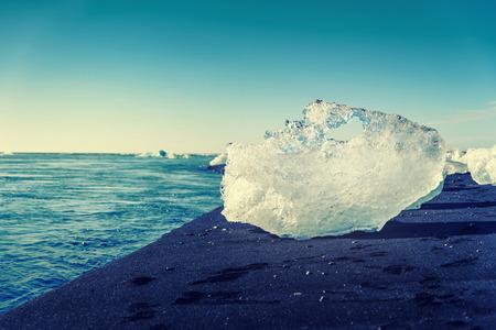 frozen lake: blue iceberg in Jokulsarlon, a large glacier lake in south Iceland, selective focus, vintage effect Stock Photo
