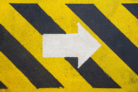 rout: walk way and white arrow sign to indicate the escape route at oil and gas platform Stock Photo