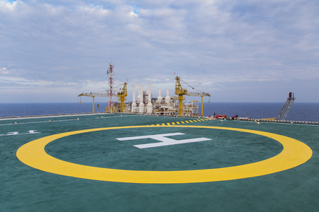 Helicopter ladnding pad at top deck floor of oil and gas processing platform