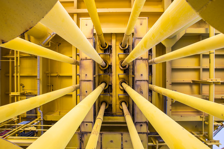 the casing: Well casing and well slot at drain deck of oil and gas remote platform. Stock Photo