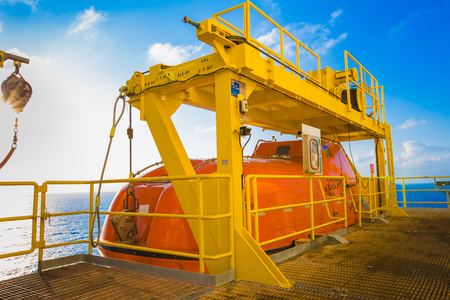 muster: Life boat or survival craft at muster station of oil and gas drilling rig Stock Photo