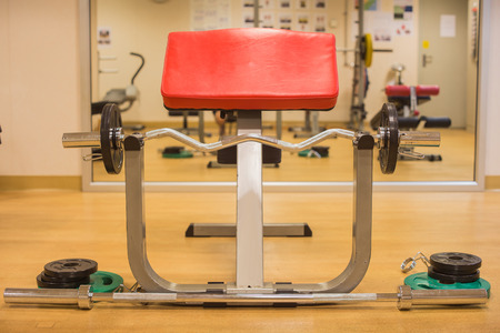 muscle building: Barbell with elbow support in gym room for weight training, muscle building