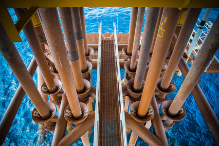 well platform: Well casing and well slot at drain deck of oil and gas remote platform. Stock Photo