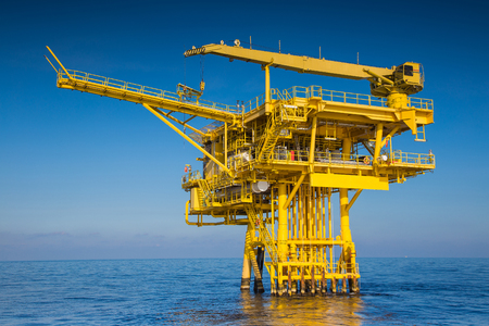 wellhead: Oil and gas wellhead remote platform produced raw gas and oil then sent to central processing platform to seperate water,gas and condensate ( Crude oil )  then sent to onshore and tanker Stock Photo