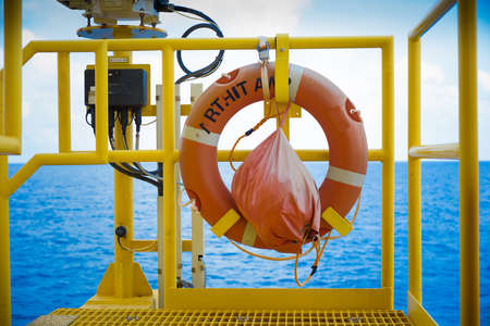 buoy: The life buoy with tag line installed at gas platform.