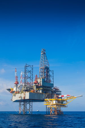 offshore jack up rig: Oil and gas drilling rig just completion on oil and gas wellhead platform