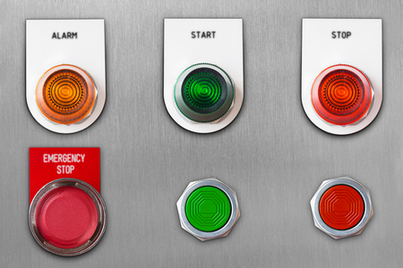 Push button switch with emergency stop and start stop alarm lamp signal on stainless steel panel wit clipping path Foto de archivo