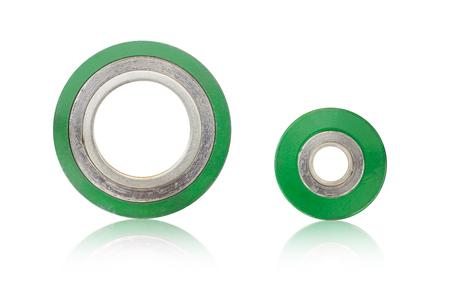 Spiral wound gasket stainless steel outer ring graphite in inner ring isolate on white background.