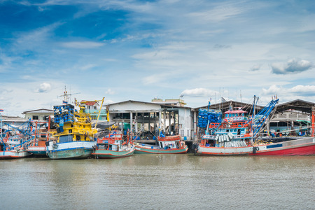 trawler net: Fishing boat at fresh sea food market in Rayong distric,Thailand. Stock Photo
