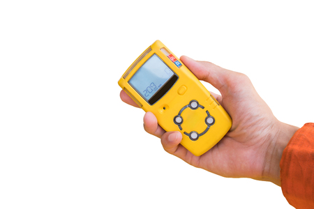 Hand hold gas detector for check gas leak isolate on white. 免版税图像