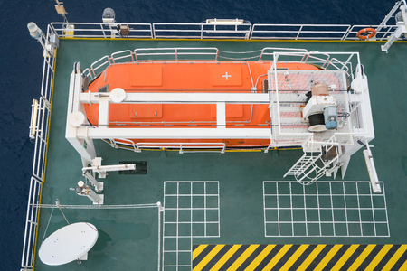 oil and gas industry: Life boat or survival craft at muster station of oil and gas accommodation platform for deploying when emergency.