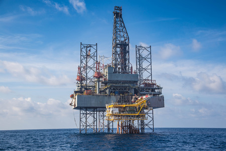 Offshore oil and gas drilling rig at the gulf of Thailand whil compleation on wellhead remote platform. Stock Photo