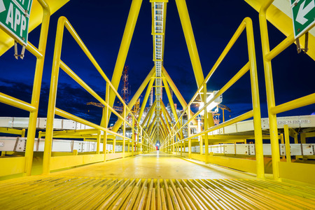 oil and gas industry: Bridge platform connected between accommodation platform and gas central processing platform, oil and gas industry plant at offshore.