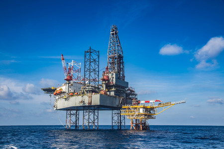 oil and gas industry: Offshore oil and gas drilling rig while completion well on oil and gas wellhead remote platform.