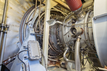 oil and gas industry: Gas turbine engine of feed gas compressor located inside pressurized enclosure, The gas turbine engine used in offshore oil and gas central processing platform. Stock Photo