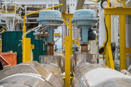Fail to close type of actuated control valve in oil and gas central processing platform, valve connected in parallel to split control method by programmable logic controller (PLC). Stock Photo