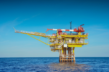 Oil and gas wellhead remote platform produced raw gas and oil then sent to central processing platform to seperate water,gas and condensate ( Crude oil )  then sent to onshore and tanker. Stock fotó