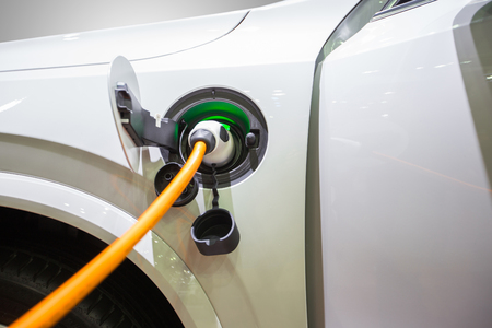 Electric hybrid car plugin in to charger to charging electric power to battery to reserve energy.