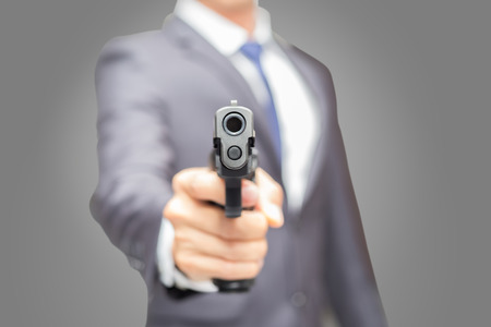 Office man holding semi-automatic gun, Body guard and security concept.
