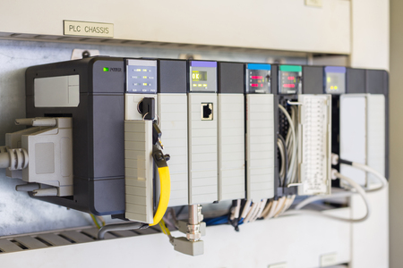 Programmable Logic Controller PLC comprised of analog and digital input and output with power supply and processor module this being used in oil and gas control process. Stockfoto